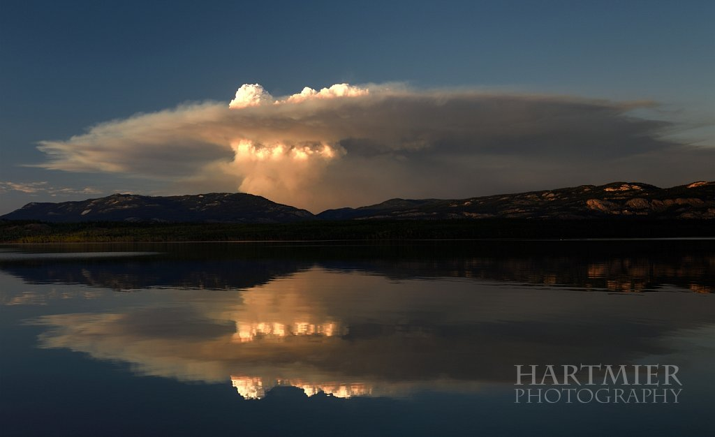 "Forest Fire reflects on  the ""Marge of Lake Laberge"""